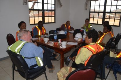 Minister of Natural Resources, Raphael Trotman and team at a round table discussion with CEO of Troy Resources, Ken Nilsson, at Karouni, Region 7
