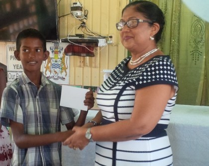 Male top performer receives prizes from Mrs. Sita Nagamootoo