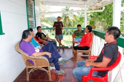Minister of Indigenous Peoples' Affairs, Sydney Allicock in discussion with some residents of Kamarang, Region Seven