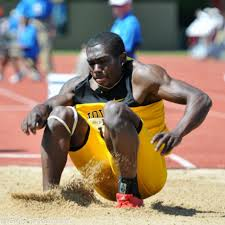 Troy Doris representing Guyana in the triple jump event