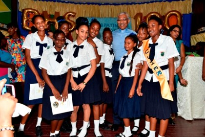 President David Granger poses with some of the current students of the Berbice High School at the school's centenary celebrations, earlier today.