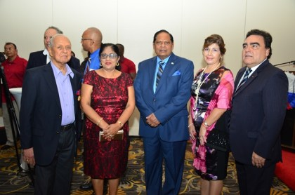 Prime Minister Moses Nagamootoo, and Mrs. Sita Nagamootoo pose with attendees at the reception in honour of Chile's 206th Independence anniversary