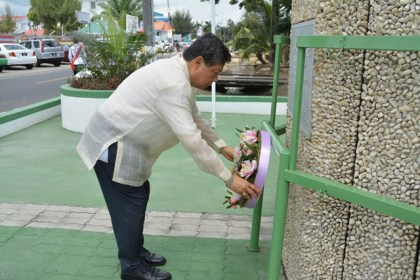 Ambassador Jose de la Rosa Burgos laying a wreath at the Independence Arch on Brickdam, Georgetown after he was accredited by President David Granger