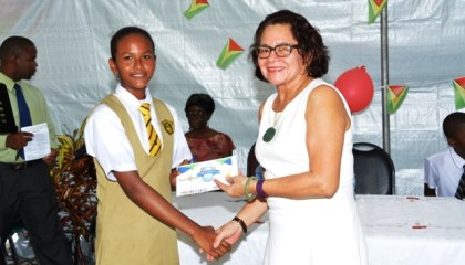 Top East Coast Student, Aletha Joseph receives her award from First Lady, Mrs. Sandra Granger