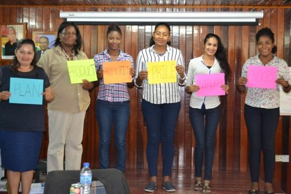 Participants, displaying posters of the 6 'P's of Business