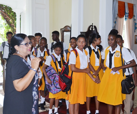 Mrs. Sita Nagamootoo with students of the Cummings Lodge Secondary during their visit to the Prime Minister's official residence
