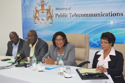 Minister of Public Telecommunications Cathy Hughes addressing media operatives. To her far right is Clement Henry, Project Manager of the Citizens Security Strengthening Programme, to her immediate right, Floyd Levi, Project Manager – E- Governance Project and to her left Marjorie Chester, Public Relations Officer of the Ministry of Public Telecommunications