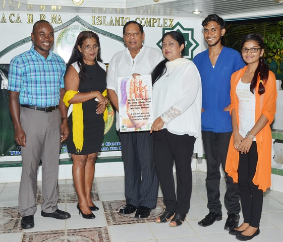 Prime Minister Moses Nagamootoo and wife, Sita Nagamootoo with representatives of The Caribbean Voice at the Anna Catherina Islamic Complex's vigil