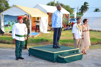 President David Granger along with Minister of Indigenous Peoples Affairs Sydney Allicock and Minister within the Ministry of Indigenous Peoples Affairs Valerie Garrido-Lowe taking the salute at the launch of Indigenous Heritage Month at the Heritage Village, Sophia Complex