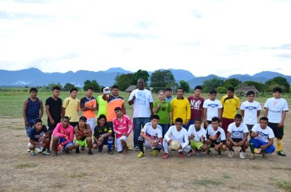 Minister within the Ministry of Communities Hon. Dawn Hasting- Williams and Mayor of Lethem Carlton Beckles and the Nappi Football team.