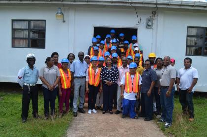 Minister of Social Protection Volda Lawrence, Minister within the Ministry, Keith Scott and other officials with the 31 participants of the heavy duty equipment operator programme in Mahdia, Region Eight