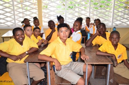 Brickdam Secondary School students in their new classroom