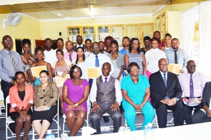 The graduating class from the Financial Literacy and Small Business Training with officials from the Ministry of the Presidency –Office of Presidential Advisor on Youth