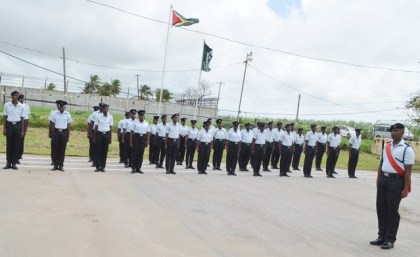 Graduate Prison Officers on the drill square at the Cecil Kilkenny Prison Officers' Training School, Lusignan