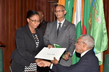 President David Granger presents the Instrument of Appointment to Justice Roxanne George-Wiltshire, Chairperson of the Tribunal