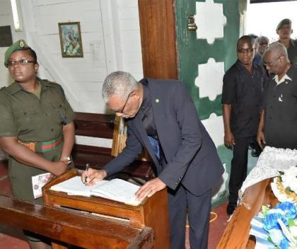 President David Granger signing the Book of Condolence at the church