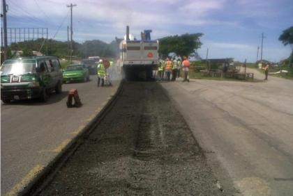 Contractors working on the sidewalk for the West Coast road