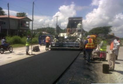 Contractors overlaying the West Coast road