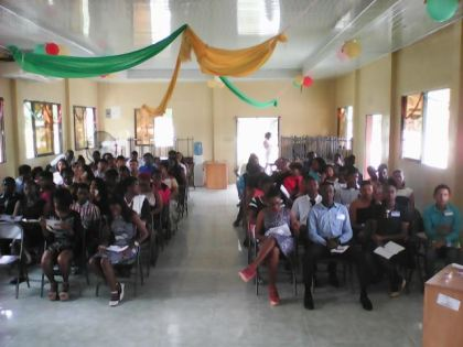 Participants seated in the Lecture Hall at Madewini Training Center.