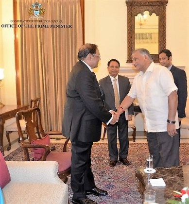 Retired General Dr. Vijay Kumar Singh, India's Minister of State for External Affairs greets Prime Minister Moses Nagamootoo at Hyderbad House, New Delhi