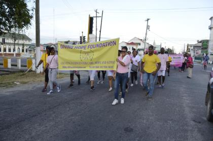 Representatives from the Giving Hope Foundation and other stakeholders march along Church Street