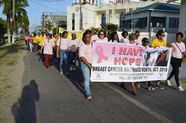 First Lady, Mrs. Sandra Granger and other marchers move apace, along Church Street