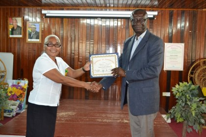 "Stephanie Persaud receiving her certificate from Regional Executive Officer, Mr. Brentnol Hopkinson.  Stephanie Persaud started off selling honey in recycled bottles to make a living. She has been very successful in expanding her business where she now sells Carsareep and rears chickens. ""I am going to put the 6P's into practice [Planning, Paperwork, Products, Promotion, Price and Process] and I know I am going to do better."""