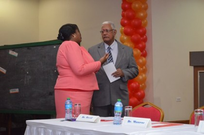 Minister of Agriculture, Noel Holder and Registrar of the PTCCB, Tricia Garnath in discussion at the PTCCB drama competition finals at the Ramada Princess