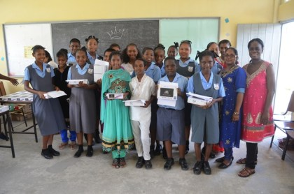 Some of the Grade 7 Students of the Diamond Secondary School with their tablets