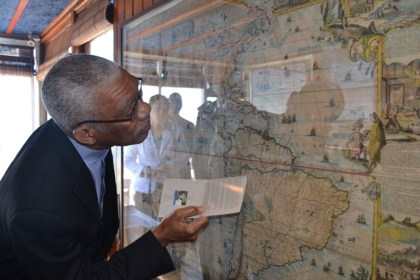 President David Granger takes a close look at a map mounted in Neruda's house in Valparaiso.