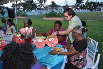 Mrs. Sandra Granger, giving out tokens to retired head teachers.