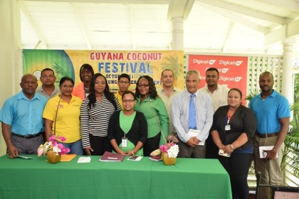 Director General of Tourism, Donald Sinclair (left) and Director of the Guyana Tourism Authority Harold Singh with the sponsors of the coconut festival