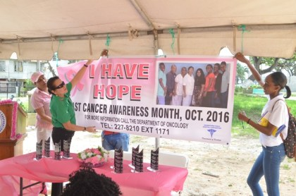 First Lady Sandra Granger, rolls out the Breast Cancer Awareness month banner for 2016