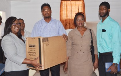 Minister within the Ministry of Public Health, Dr. Karen Cummings hands over medical supplies to Doctor in Charge of Wakenaam Cottage Hospital, in the presence of Director of Regional Health Services, Dr. Kay Shako and Regional Health Officer Region Three Dr. Naail Uhtman