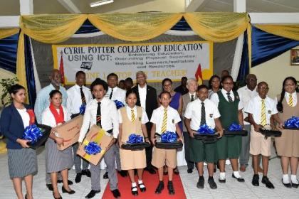 President David Granger with teachers and students, who received laptops at the launch of the One Laptop Per Teacher (OLPT) initiative