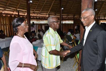 President Granger shares a light moment with these two residents from the Upper Demerara-Berbice (Region Ten) who were treated today at the Umana Yana.