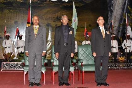 From left: Chancellor of the Judiciary, Justice Carl Singh, President David Granger and Director of Protocol of the Ministry of the Presidency, Colonel (Ret'd) Francis Abraham, during the singing of the National Anthem.