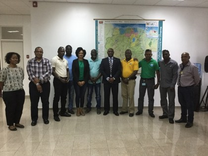 Suriname's Minister of Natural Resources Mr. Regilio J. Dodson flanked by GWI and SWC officials.