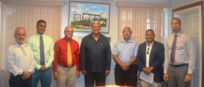 L-R Mr. Ivan Cabrera, Mr. Avinash Rampersad, Mr. Nirmal Rampersad, Minister Noel Holder, CEO of GuySuCo Mr. Errol Hanoman, Mr. Noel Shewjattan and CEO of GO Invest Mr. Owen Verwey