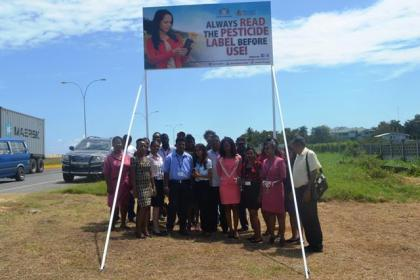 Staff of the PTCCB infront of the newly erected billboard