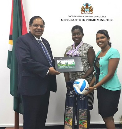 Prime Minister Moses Nagamootoo, with teachers from Corentyne Comprehensive High School, Miss Shauna Sinclair-Paul and Miss Bisoondai Lokhai