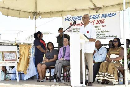 President David Granger addressing the residents of Victoria Village and surrounding areas at the National Day of Villages Observance held there today.