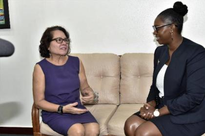 First Lady, Mrs. Sandra Granger in discussion with Mrs. Natasha Clarke- Solomon, founder of The El Dorado Foundation Incorporated.