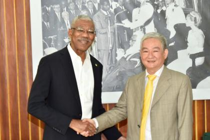 President David Granger and China's Ambassador to Guyana, Mr. Zhang Limin at the Ministry of the Presidency