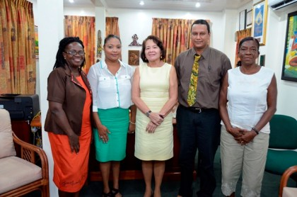 First Lady, Mrs. Sandra Granger (centre) is flanked by, from left to right: Ms. Maureen Daniels-Clarke, Ms. Alana Clarke, Ms. June Archer and Mr. Joel Sutherland of CYLAN Foundation.