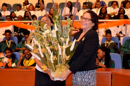 A huge thank you! First Lady, Mrs. Sandra Granger and Head Prefect of the 2017 graduating class of the Carnegie School of Home Economics, Ms. Sheina Ramsden share a laugh as they display a stunning bouquet the school presented to the First Lady in appreciation of her attendance.