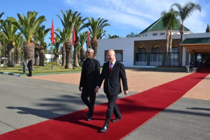 President David Granger being escorted to board the aircraft at the with at the Mohammed V International Airport in Casablanca for the final leg of his journey to Marrakesh by Mr. Anis Birou, Minister of Moroccan Community Abroad and Immigration affairs, who had earlier officially welcomed him to Morocco.