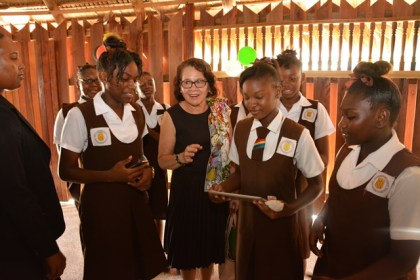 First Lady, Sandra Granger interacting with some of the students who attended the launch of the 2016 State of the World Population Report at the Umana Yana
