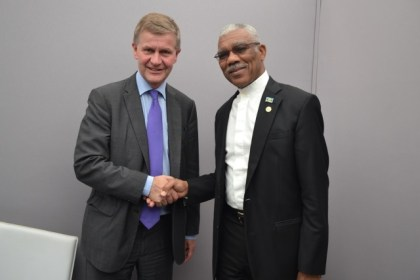 President David Granger exchanges a hand shake with Mr. Erik Solheim, Under Secretary- General of the United Nations and Executive Director of the United Nations Environment Programme (UNEP) at the COP 22 Village, Marrakesh, Morocco. Mr. Solheim is the former Minister of the Environment and International Development of Norway, who on behalf of his Government, was in Guyana to establish the Guyana REDD+ Investment Fund (GRIF) Agreement back in 2010. He had also signed the Memorandum of Understanding (MoU) between Guyana and Norway with former President Bharrat Jagdeo, on the banks of the Essequibo River, for the funding of the Low Carbon Development Strategy (LCDS).
