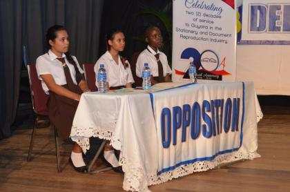The victorious Annandale Secondary School team at the J.O.F Haynes Memorial Haynes Inter-Secondary Schools Debating competition at the Theatre Guild Playhouse